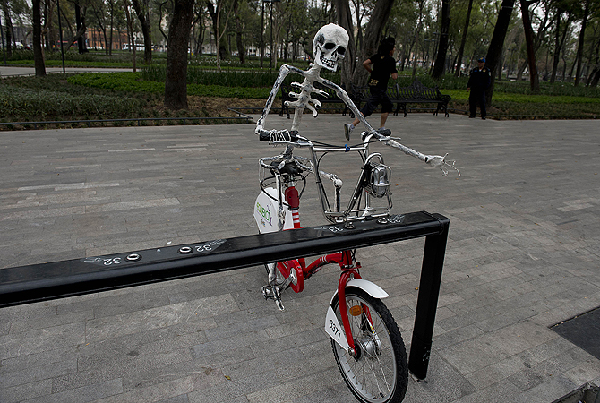 "A skeleton riding a bicycle is displayed to demand more safety to users of the individual transport system ""Ecobici"" at the Alameda Ecobici station along Juarez Avenue in Mexico City on April 5, 2013. According tothe  Ministry of Environment of the Federal District more than forty-five thousand people are using the system of Ecobici which looks for an alternative to reduce the pollution in one of the more crowded cities around the world."