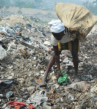 A Haitian woman searches for recycable trash to sell on April 4, 2013 at a dump south of Port-au-Prince. The Haitian Human Rights Organizations (POHDH) believes that the degrading environmental situation of Haiti threatens the survival of the population and calls for an awareness of all citizens and the commitment of the government in resolving the issue.