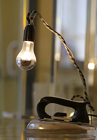 A table lamp made from an old iron is displayed at the 'Unico' showroom during the Milan's Design Fair, in Milan, Italy.