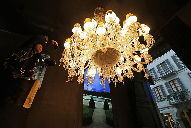 A crystal chandelier designed by French designer Philip Stark for Baccarat is displayed at Milan's Design Fair, in Milan, Italy.