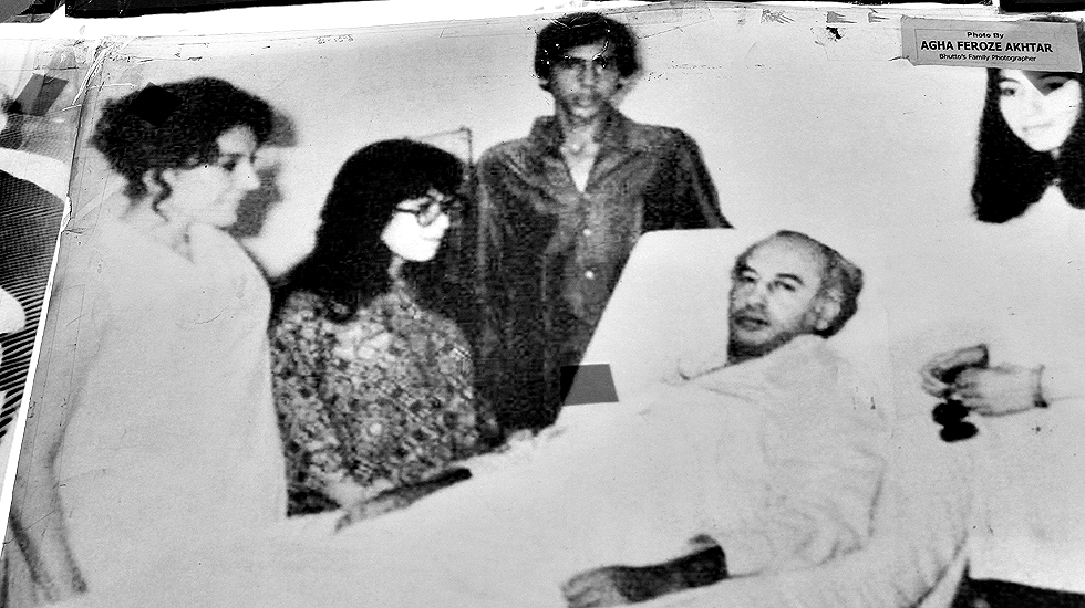 An unwell Zulfikar Ali Bhutto being visited by his family at a local hospital.