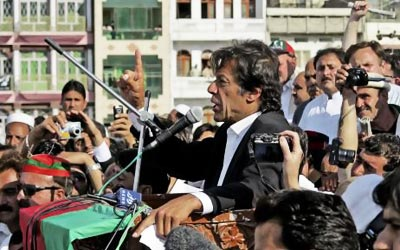 Pakistani cricketer-turned politician Imran Khan addresses his supporters during a rally in the northwestern city of Mingora. His Movement for Justice party appeals to a young, urban constituency tired of the corruption that plagues the system. —Photo (File) AP