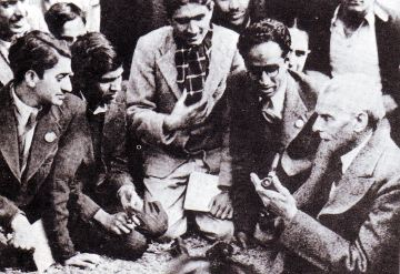 A group of Muslim student activists gather around Jinnah.