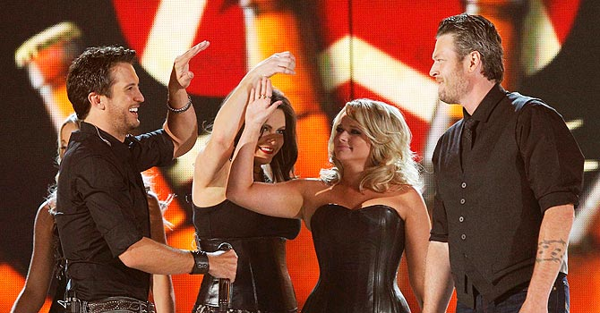 Hosts Luke Bryan (L), Miranda Lambert and Blake Shelton perform at the 48th ACM Awards in Las Vegas. —Photo by Reuters
