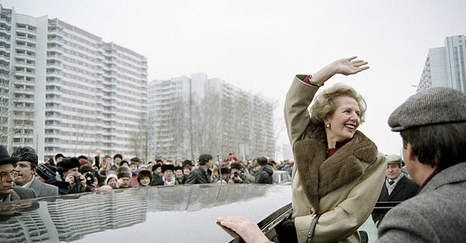 A picture in 1987 shows then British Prime Minister Margaret Thatcher greeting curious Moscovites who gathered to see her in Moscow, during her official visit in USSR. —Photo by AFP