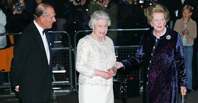 Margaret Thatcher (R) greets Britain's Queen Elizabeth II (C) and Britain's Prince Philip (L) arriving for Thatcher's 80th birthday party in 2005.  —Photo by AFP