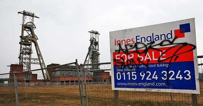 A for-sale sign stands by the closed Clipstone Colliery in Clipstone, central England. Communities ravaged by the decline of heavy industry during her time in office said they would shed no tears. Only three deep coal pits now remain in the UK, according to Britain's Coal Authority, out of the 170 in operation in 1984 at the time of the miners' strike. —Photo by Reuters