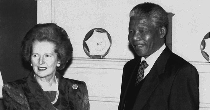 A 1990 picture shows Margaret Thatcher shaking hands with ANC deputy leader Nelson Mandela inside 10 Downing Street, London, prior to talks and a luncheon. Nineteen years after the end of apartheid, South Africans are still passionately divided over whether Margaret Thatcher helped or hindered the demise of the cruel system of white rule and prolonged the jailing of Nelson Mandela. —Photo by AP