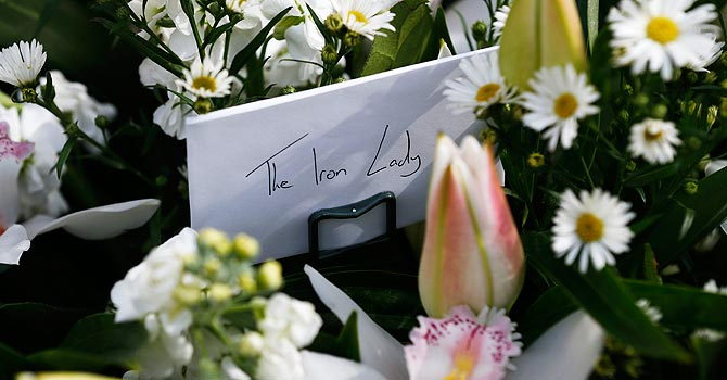 Floral tributes are seen being left outside the house of former British Prime Minister Margaret Thatcher in London. —Photo by AP