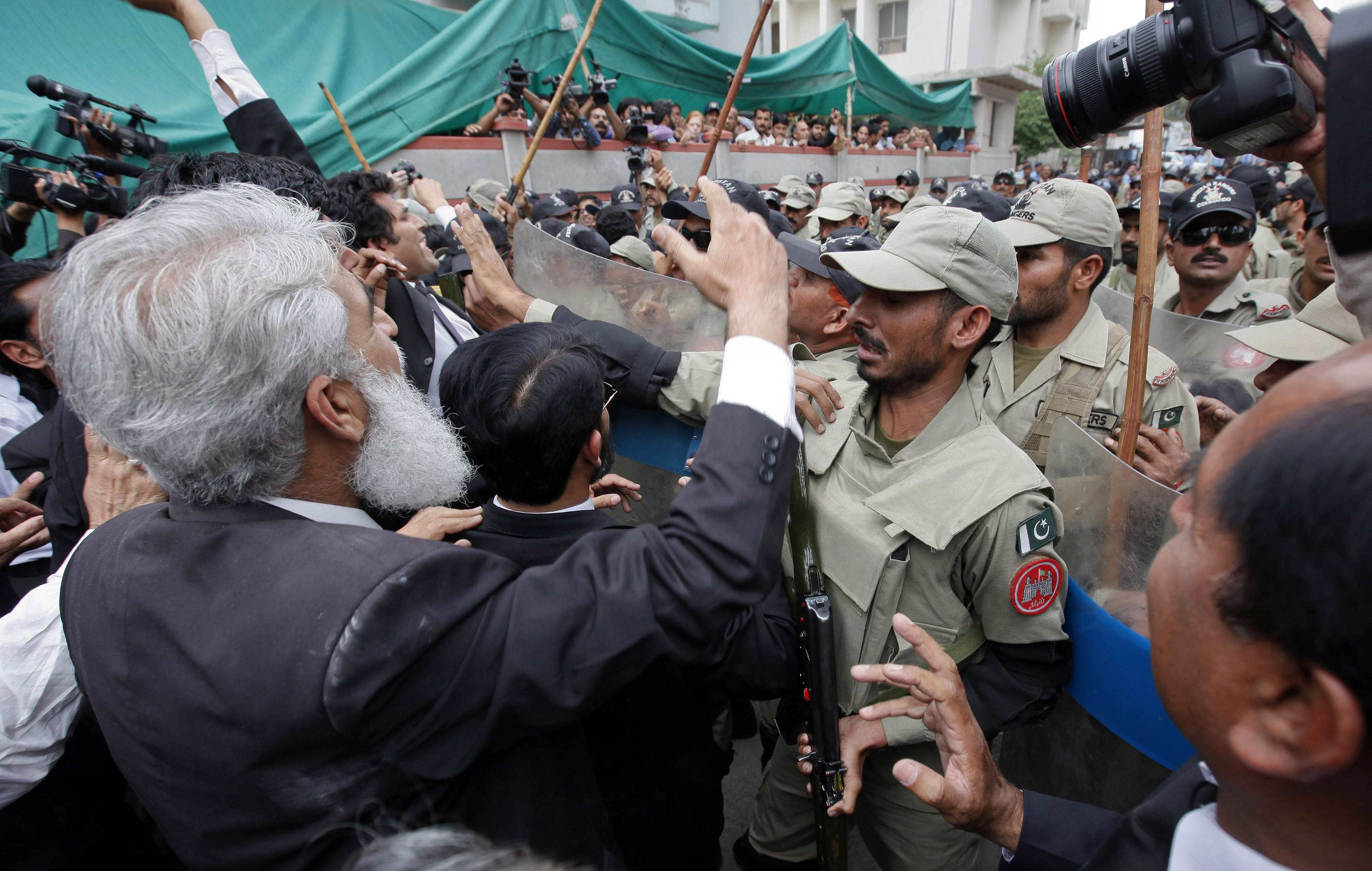 Lawyers shouting anti-Musharraf slogans scuffle with paramilitary soldiers outside the anti-terrorism court where former Pakistani president and head of the All Pakistan Muslim League (APML) political party Pervez Musharraf is attending a hearing, in Islamabad April 20, 2013. — AFP Photo