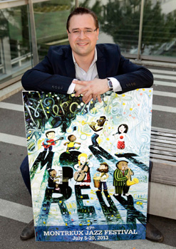 Mathieu Jaton, head of Montreux Jazz Festival poses with this year's poster after the presentation in Lausanne.