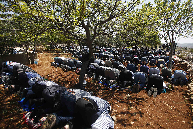 Palestinians pray before a protest against what they say is an attempt by Israeli settlers to confiscate Palestinian land, outside the village of Silwad, near the West Bank city of Ramallah.