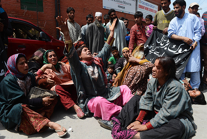 A Kashmiri Muslim family lies on the road shouting anti-police slogans during a protest over a relatives death in Srinagar, after the victim was allegedly attacked inside Srinagar's central jail. The victim died of head injuries after going to a local hospital and his family allege that he was killed inside the jail by the police, while police say he was killed by another inmate. India has just over 370,000 people in jail according to the most recent data by the International Centre for Prison studies.