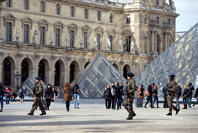 "French militaries patrol at the ""Cour Carree"" of the Louvre Museum in Paris. Paris's Louvre museum today reopened its doors to the public after a walkout by some staff in protest at gangs of pickpockets operating at the world famous art gallery. Around 20 police officers have now been drafted in to patrol the museum in response to staff concerns, Louvre officials told AFP. The day before, the Louvre failed to open when around 200 employees refused to work saying the museum had become plagued by gangs of increasingl"
