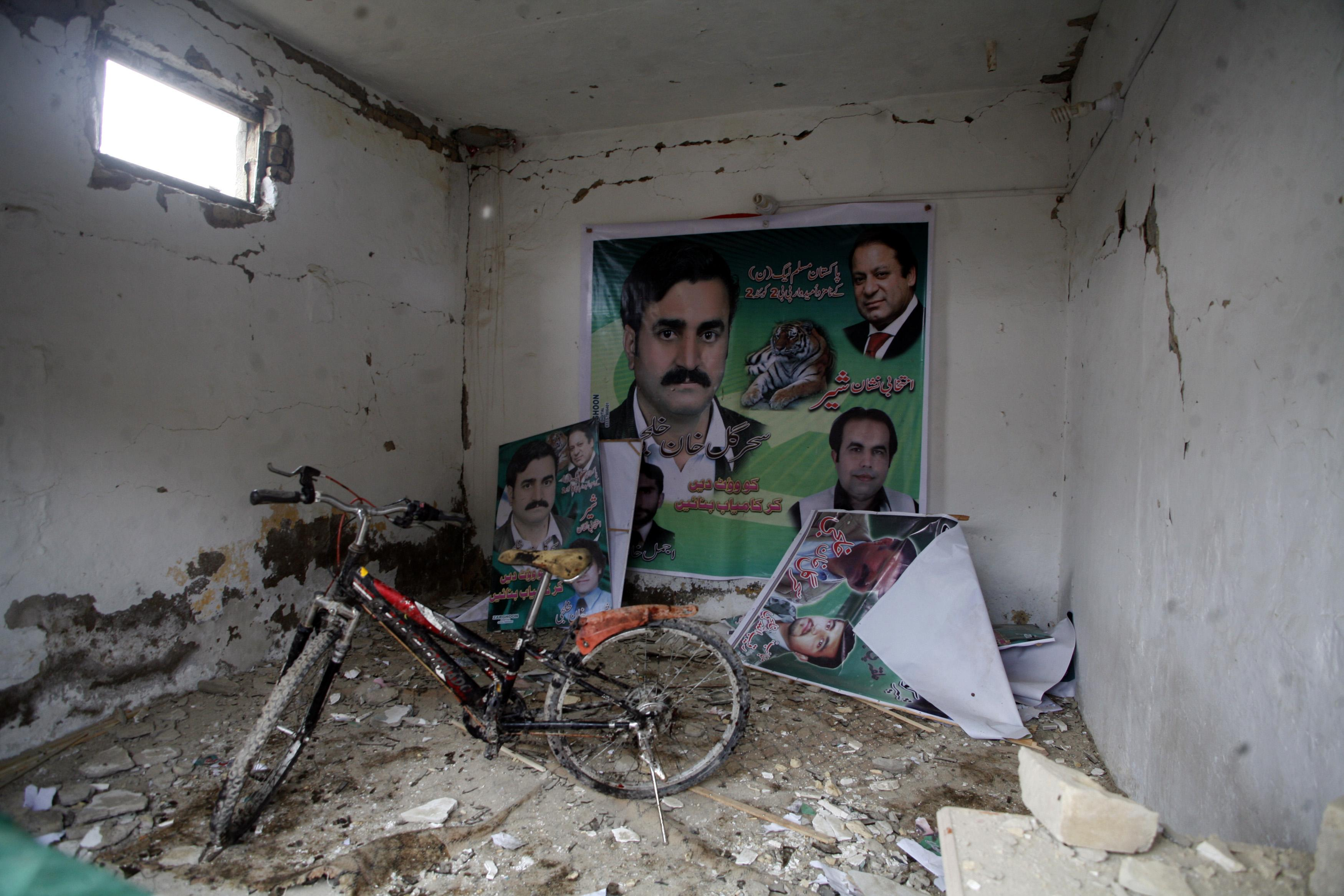 Debris is pictured in a damaged office of Pakistan Muslim League (N) after Tuesday's bomb blast in Quetta April 24, 2013. A prominent leader of Pakistan's ethnic Hazara minority narrowly escaped the suicide attack that killed six people on Tuesday, underscoring the growing threat militants pose to secular politicians in the run-up to next month's general elections. The blast in Quetta was the worst attack since a series of bombings in the city at the start of the year killed almost 200 people, briefly drawing globa