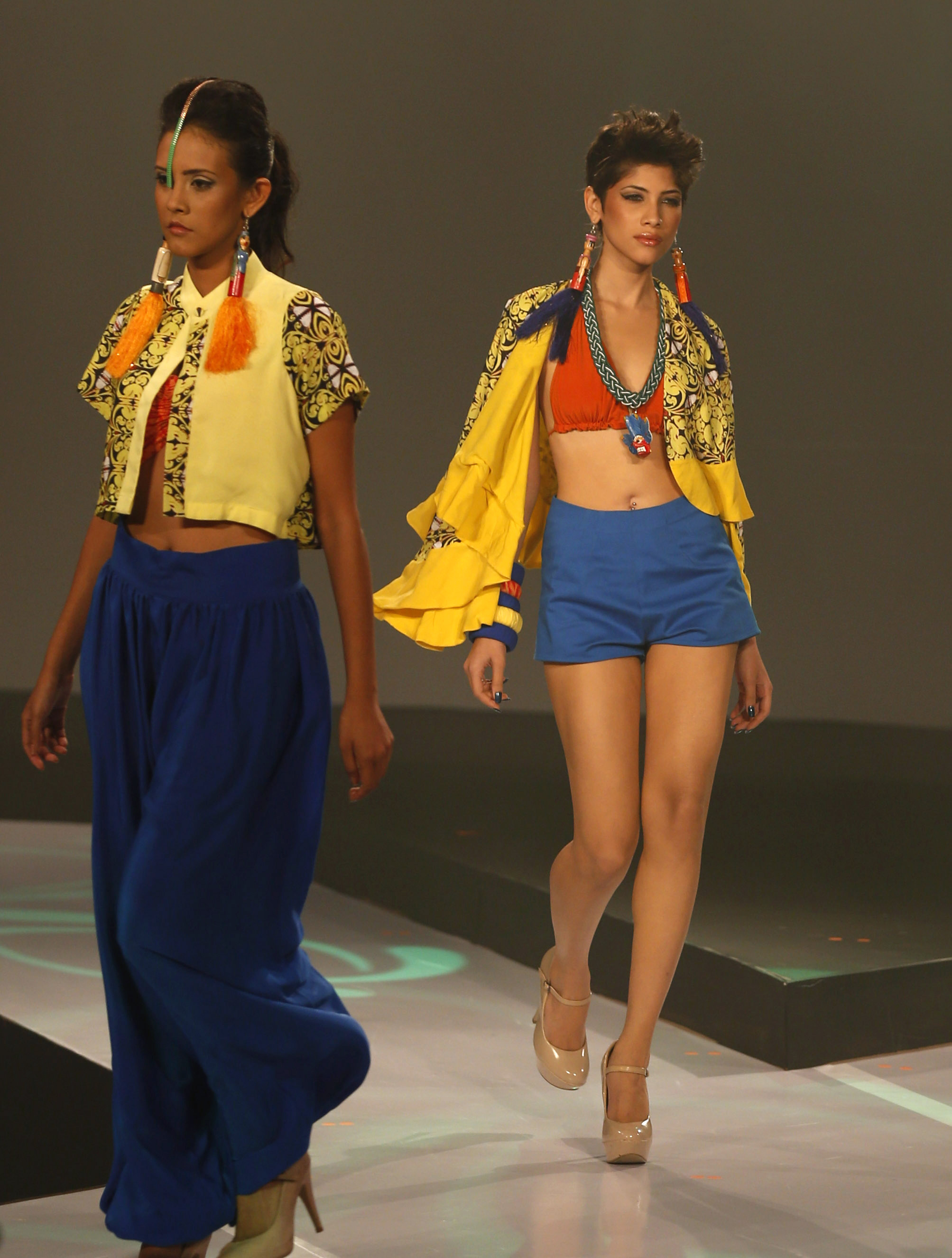 Sri Lankan models present creations by Charini Suriyage during Colombo Fashion Week in Colombo, Sri Lanka.