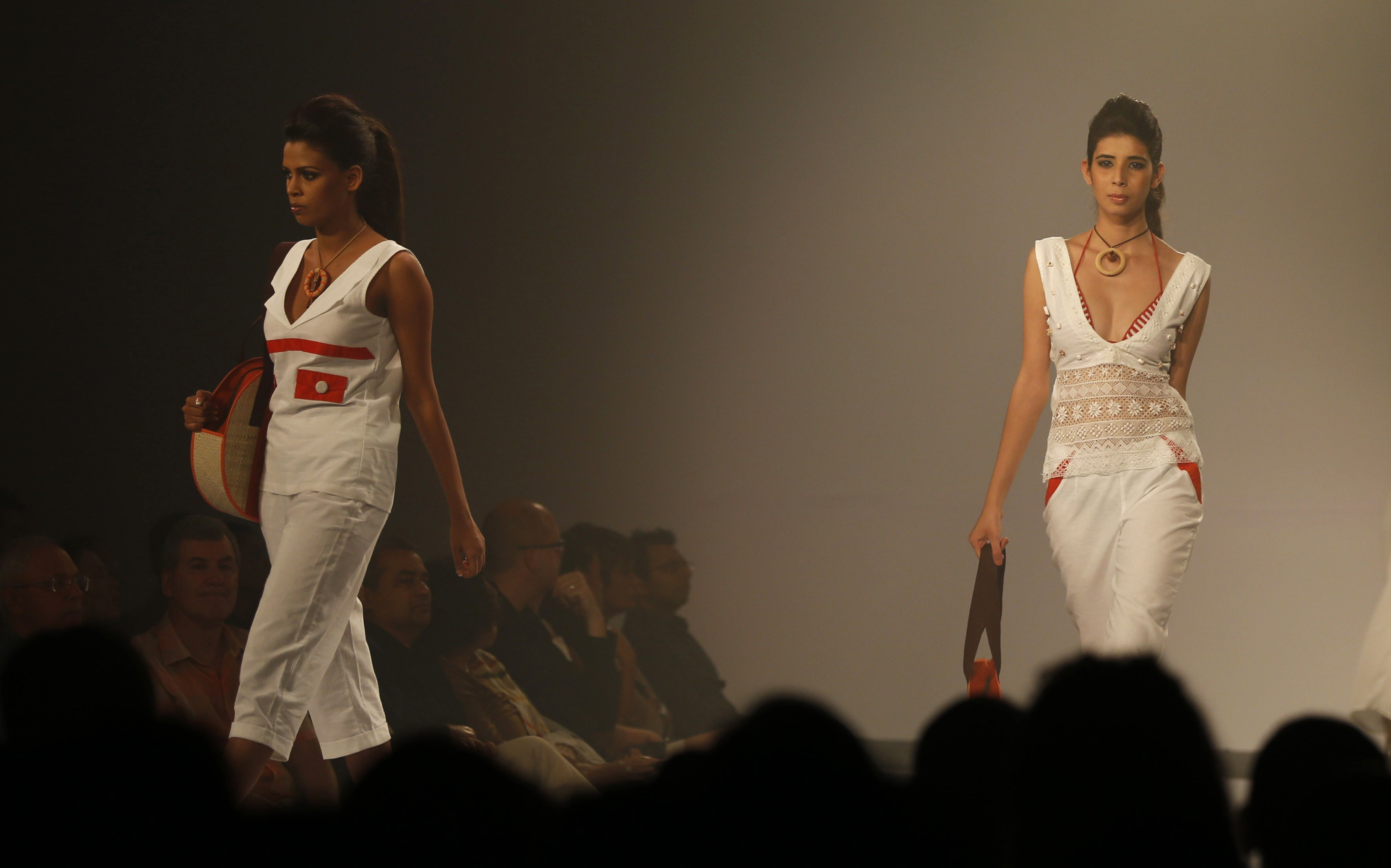 Sri Lankan models present creations by Kasuni Ratnasekera during the Colombo Fashion Week in Colombo, Sri Lanka.