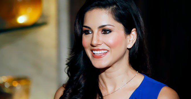 "Sunny Leone, who stars in Bollywood film ""Jism 2"" speaks to the media in Mumbai, India.–Photo by AP"