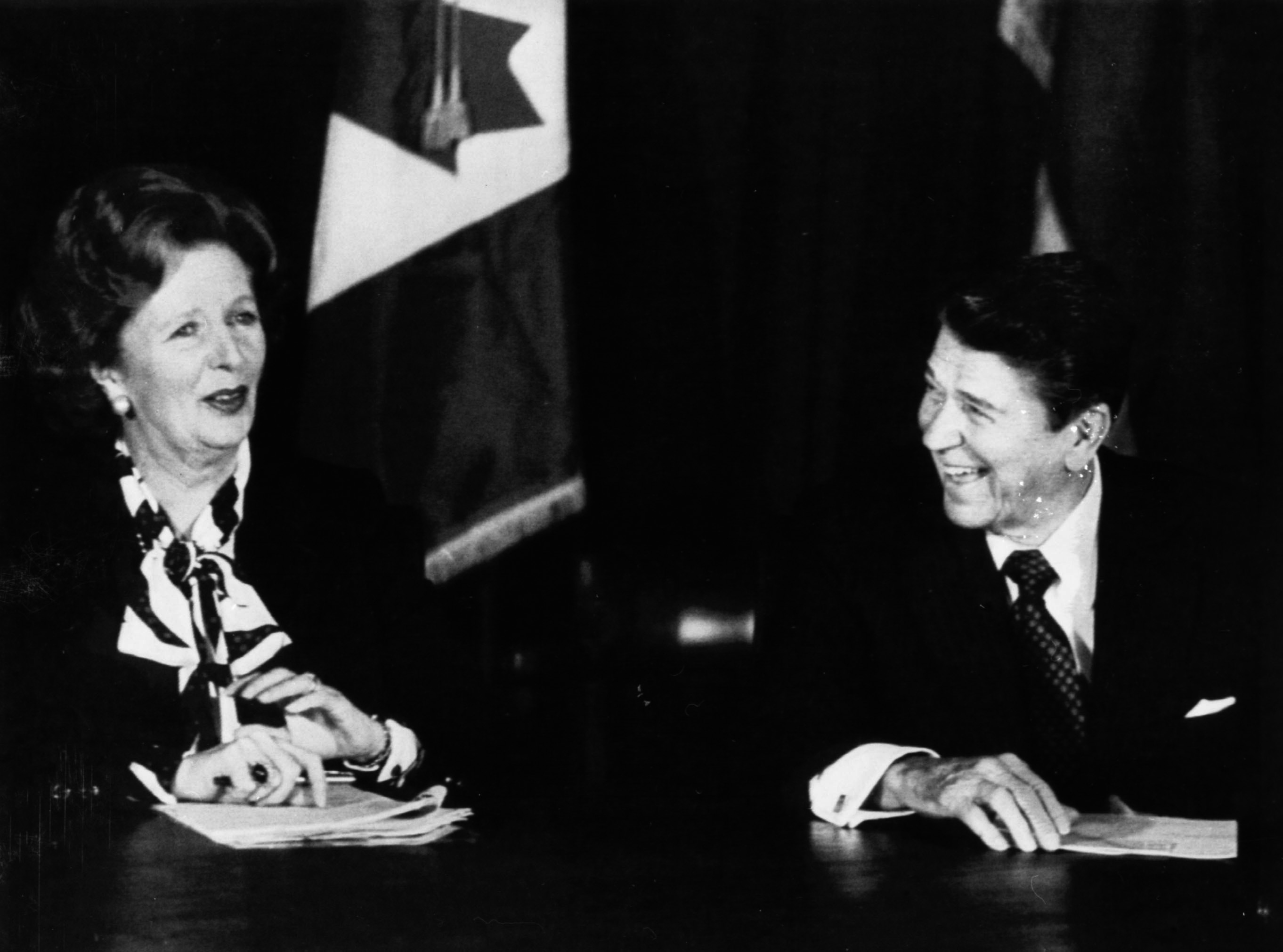 Then British Prime Minister Margaret Thatcher (L) and then U.S. President Ronald Reagan share a laugh during a meeting of the Allied leaders in New York in this October 24, 1985 file photo.