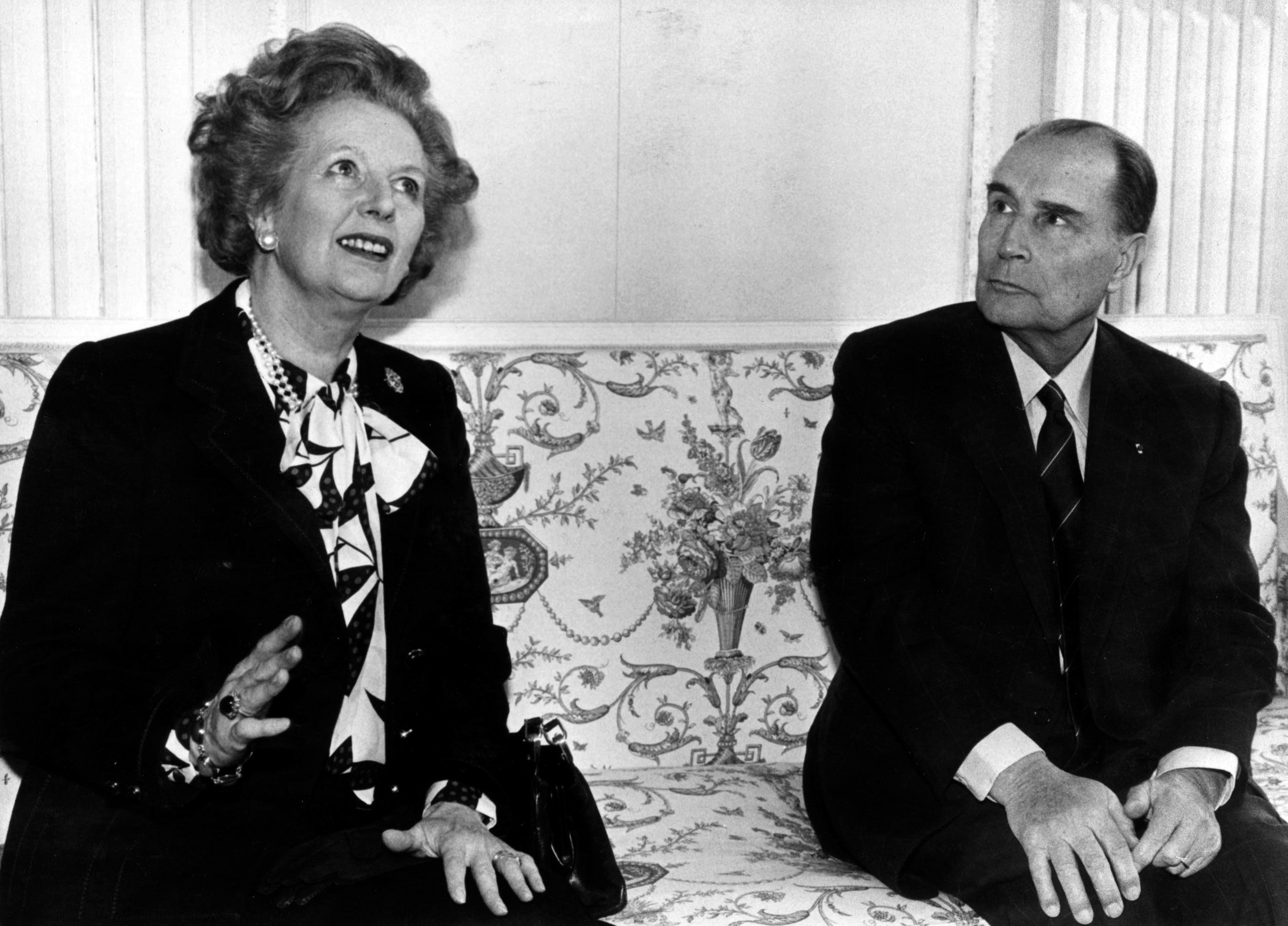 British Prime Minister Margaret Thatcher (L) and French President Francois Mitterrand talk to the media before a meeting about nuclear arms control at the Chateau de Benouville in Normandy, western France in this March 23, 1987 file photo.