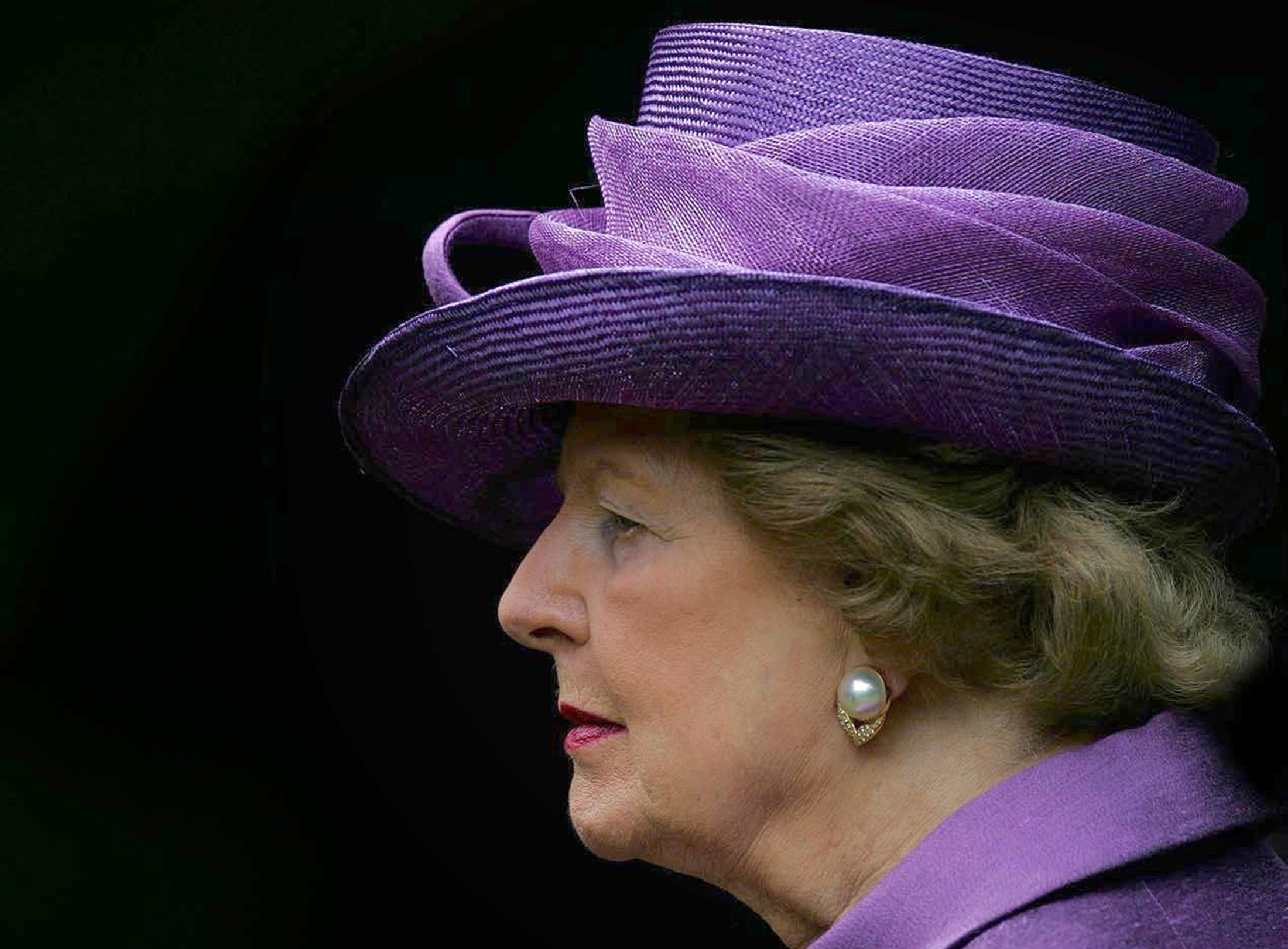 Britain's former Prime Minister Baroness Thatcher attends a service to commemorate the 25th anniversary of the liberation of the Falkland Islands from Argentine occupation by British forces, at the Falkand Islands Memorial Chapel at Pangbourne College, Berkshire, southern England in this June 14, 2007 file photo.