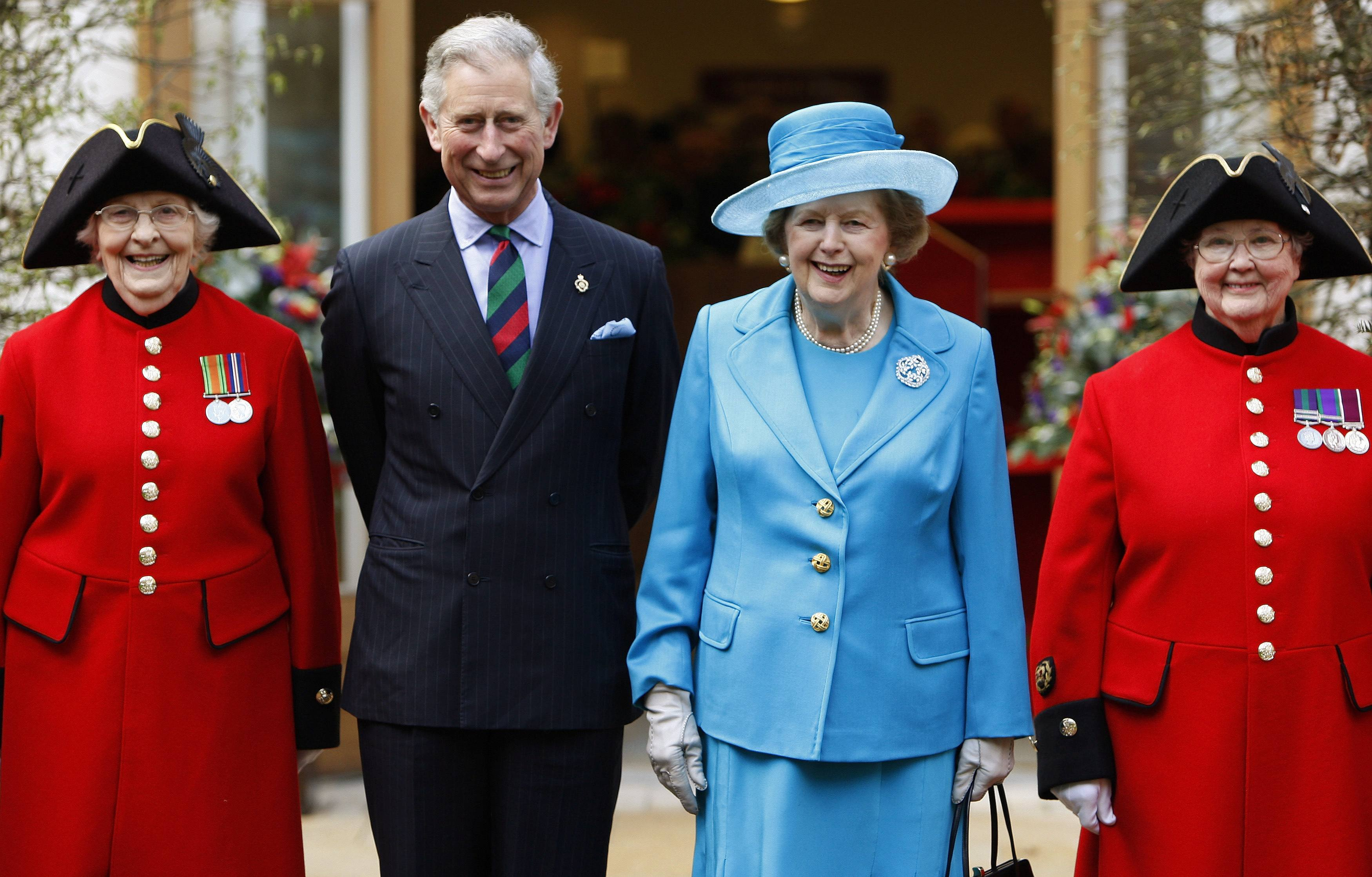 Britain's Prince Charles (2nd L) and former Prime Minister Margaret Thatcher (2nd R) pose with Chelsea pensioners Dorothy Hughes (L) and Winifred Phillips as they attend the opening of a new infirmary at the Royal Hospital Chelsea in London in this March 25, 2009 file photo.
