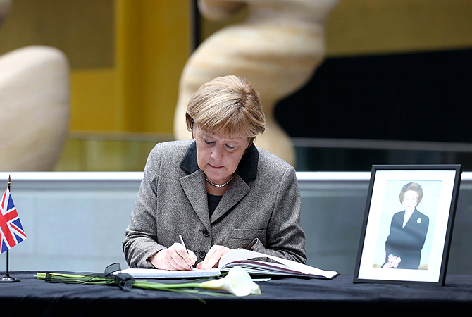 German Chancellor Angela Merkel signs a book of condolence in memory of former British Prime Minister Margaret Thatcher, who died on April 8, 2013  at the age of 87 after suffering a stroke at the British embassy in Berlin, Germany.