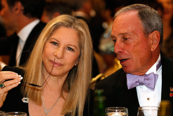 Actress and singer Barbra Streisand talks to New York Mayor Michael Bloomberg at the White House Correspondents Association Dinner in Washington April 27, 2013.