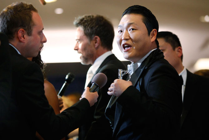 South Korean rap artist Psy gives interviews on the red carpet at the annual White House Correspondents' Association dinner in Washington.