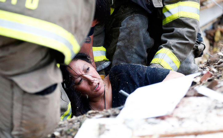 A woman is pulled out from under tornado debris at the Plaza Towers School. —AP Photo