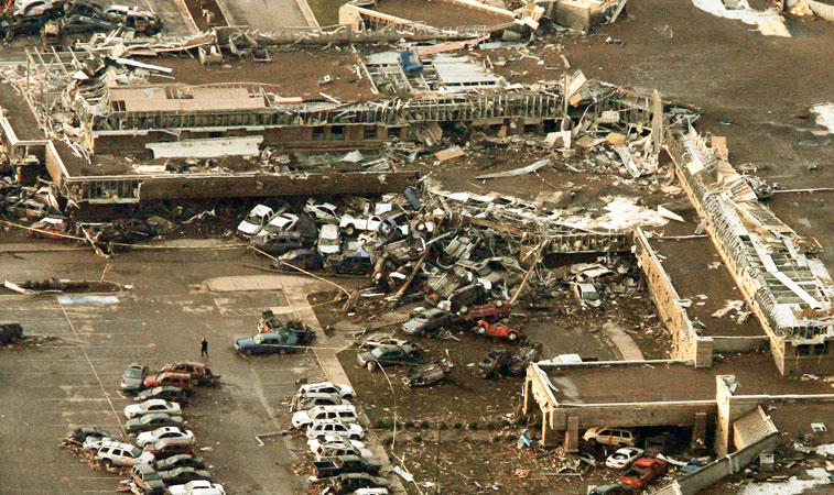 This aerial photo shows damage to Moore Medical Center after it was hit by the massive tornado. —AP Photo