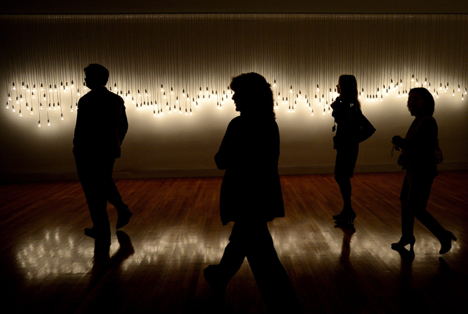Viewers walk past artist Jonathan Jones' 68 Fletcher, Bondi, 20:20, 8.6.03., during a media preview of Sakahàn: International Indigenous Art, at the National Gallery in Ottawa, Wednesday, which is the largest-ever global survey of contemporary Indigenous art— AP Photo