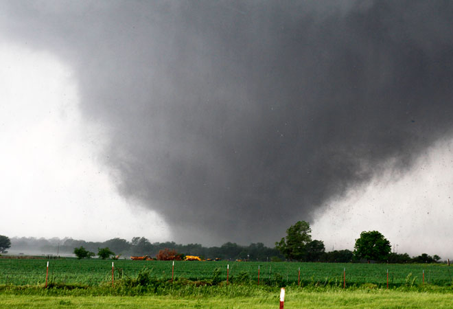 A tornado passes across south Oklahoma City. —AP Photo