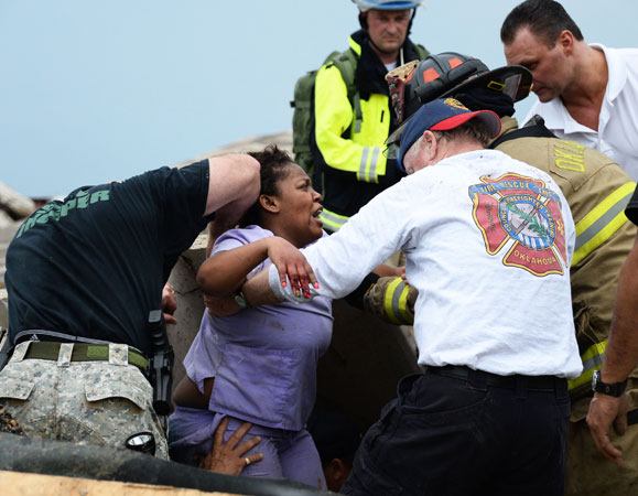 Rescue workers help free one of the 15 people that were trapped at a medical building at the Moore hospital complex after a tornado tore through the area. —Reuters Photo