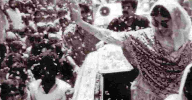 Benazir waves to the cheering crowd after he party won the most seats in the 1988 election.