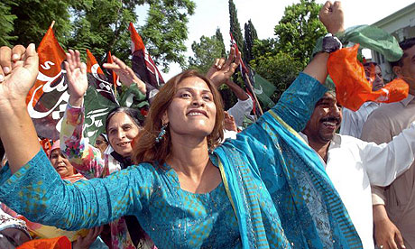PPP supporters dance to celebrate the party's victory in the 2008 election.