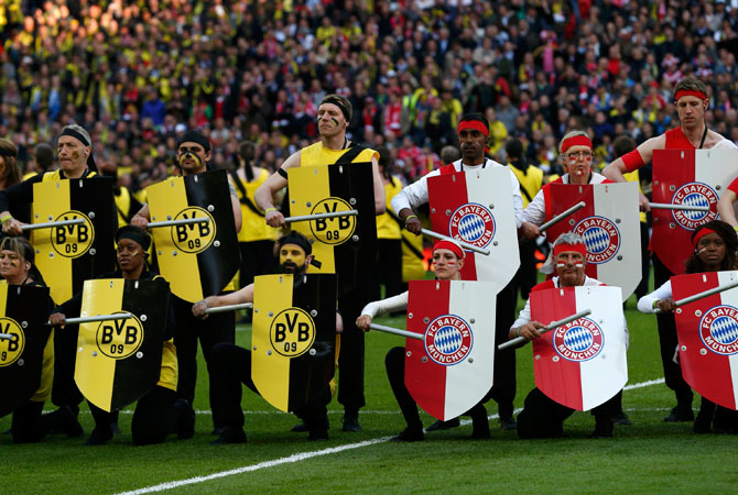 Performers take part in the opening ceremony before the start of the UEFA Champions League final football match between Bayern Munich and Borussia Dortmund at Wembley Stadium in London May 25, 2013.