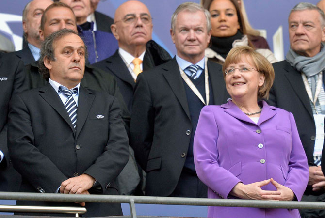 German Chancellor Angela Merkel, right, and UEFA President Michel Platini.