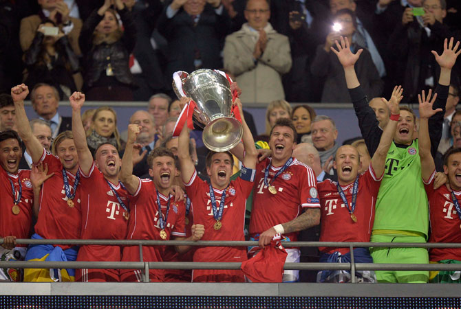 Bayern's Philipp Lahm holds up the trophy after his team won.