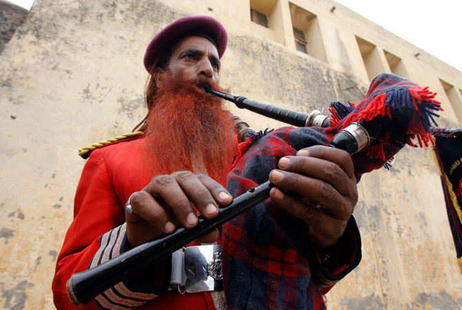 Sanaullah Haq, who was serving a life term, plays a bagpipe during a routine practice inside Kotbhalwal central jail in Jammu in this May 20, 2011 file picture.