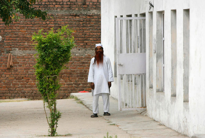 Sanaullah Haq is seen in his regular jail uniform after attending a routine practice inside Kotbhalwal central jail in Jammu in this May 20, 2011 file picture.