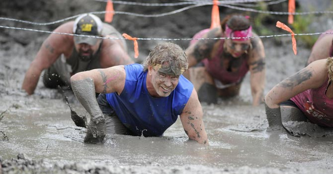 This photo provided by Nuvision Action Image LLC shows a contestant in The Mud Monster competing during The Survival Race in Dallas. —AP Photo