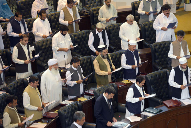 Fresh optimism: the new Khyber Pakhtunkhwa government is sworn in on the same day. They believe a change in policy to negotiation with the TTP may help curb the violence that has torn Pakistan's social fabric.