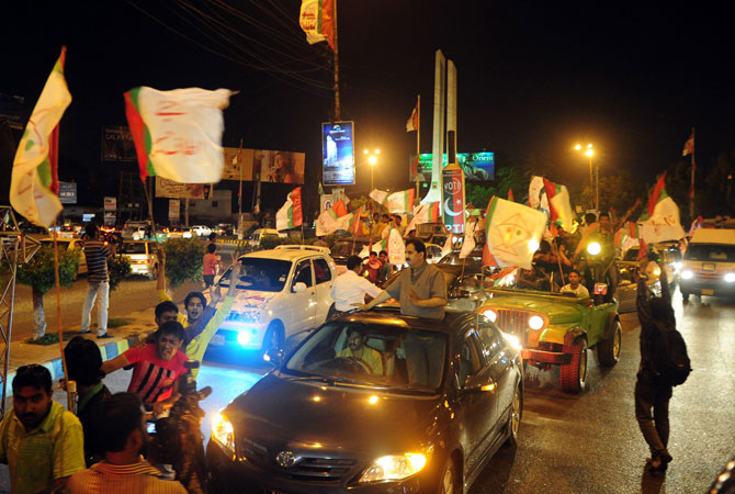 Supporters of the secular Muttahida Qaumi Movement (MQM) participate in an election campaign rally in Karachi on May 6, 2013.