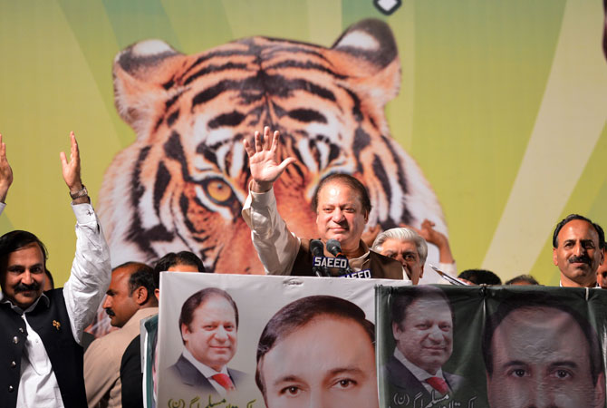 Former Pakistani Prime Minister Nawaz Sharif (C) waves as he addresses his supporters during an election campaign meeting in Islamabad on May 5, 2013.