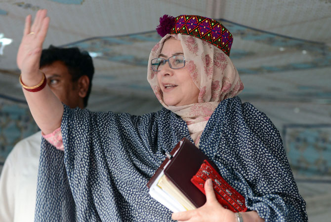Pakistani candidate for national assembly for Pakistan Muslim League-Q (PML-Q) party Ruquiya Hashmi, waves to supporters during an election campaign meeting in Quetta.