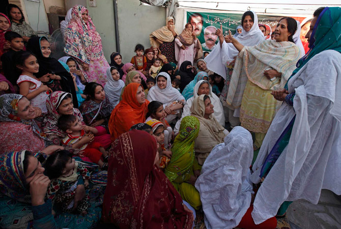 Nighat Orakzai attends a clandestine campaign rally on a roof of a building.