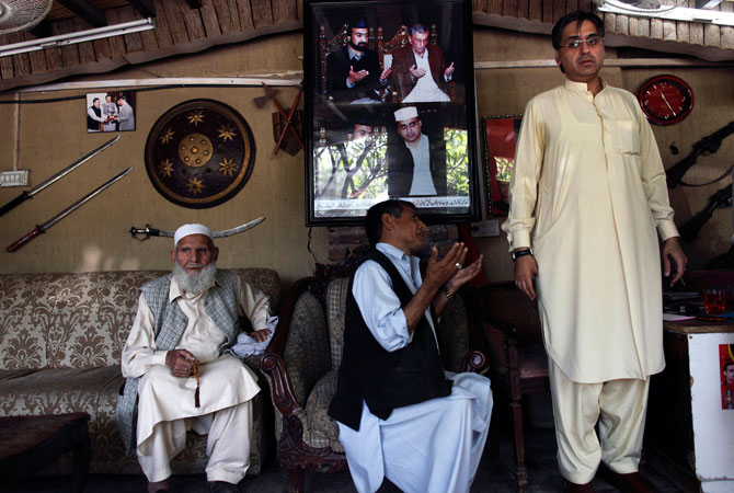 Haroon Bilour (R), an Awami National Party (ANP) candidate for the upcoming elections, meets constituents seeking help for problems at his house in Peshawar.
