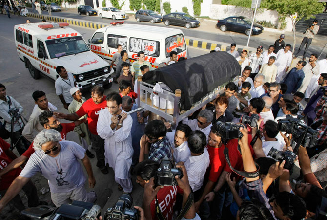 Pakistani relatives and mourners of Zahra Shahid Hussain, a senior member of former Pakistani cricket star Imran Khan's Pakistan Tehreek-e-Insaf party in Sindh, carry her body during her funeral procession in Karachi, Pakistan, Sunday, May 19, 2013. Police said gunmen on a motorcycle shot and killed her outside her home on Saturday, May 18, 2013, in the city of Karachi in the southern Sindh province.