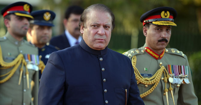 New Pakistani Prime Minister Nawaz Sharif looks on after inspecting a guard of honour during a welcoming ceremony at the Prime Minister House in Islamabad on June 5, 2013.  — Photo by AFP